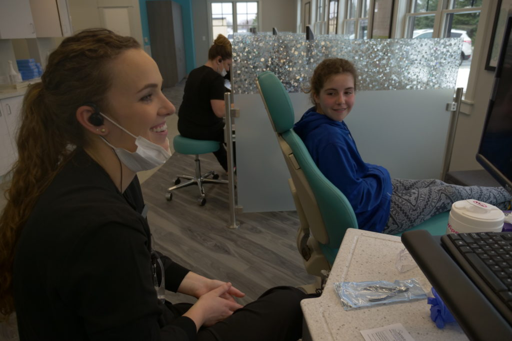 Swan Orthodontics staff working with a patient